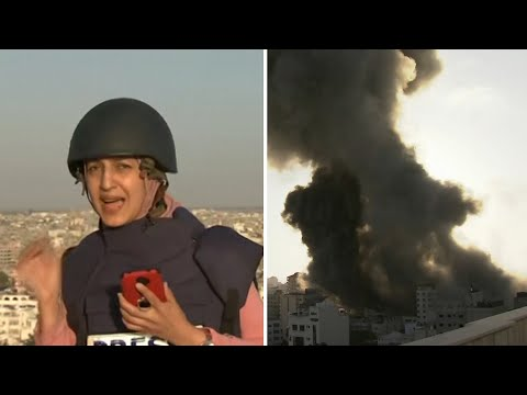 Journalist rushes for cover as Gaza building destroyed during live report