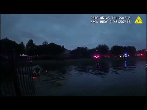 Police officers rescue woman after crashing car into Alligator infested lake