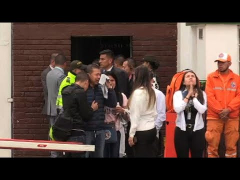 Relatives gather at the scene of apparent car bomb in Bogota