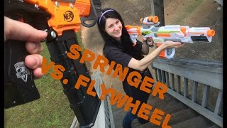NERF WAR: Flywheel Gun Vs. Springer Gun.  (Drac Vs. Draculina)
