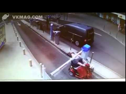 Woman on mobility scooter hitting the boom gate barrier