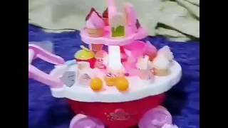 Распаковка и обзор игрушки мороженое на колесах со световыми эффектами и музыкой