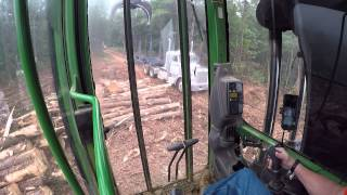 Track loader loading trucks