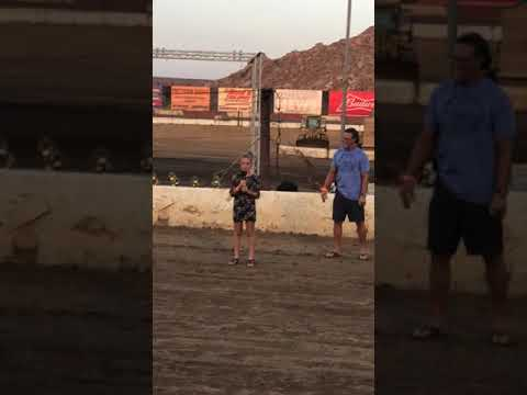 Ireland shadduck sings the national anthem at Perris Auto Speedway