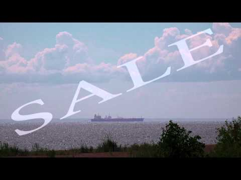 Barge on the horizon. Gulf of Finland. 4K.
