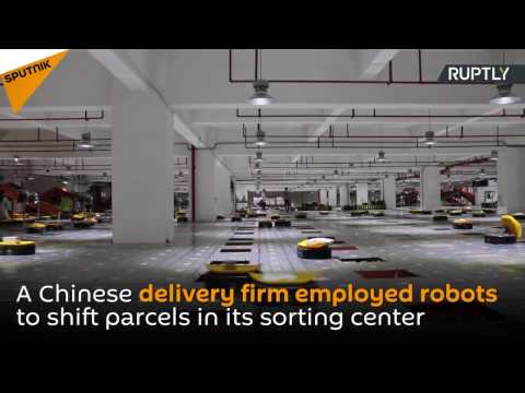 Army of Robots Sorts 200,000 Packages a Day at Chinese Deliv