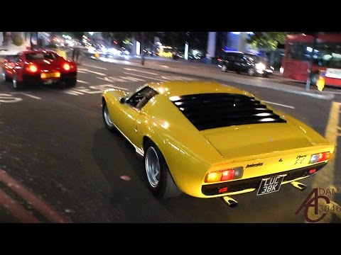 Lamborghini Miura and Ferrari 288 GTO driving together in London