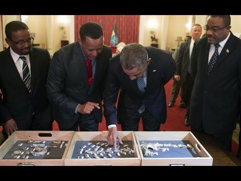 Obama touches bones of ancient ancestor