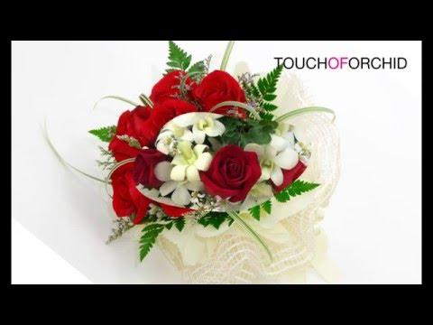 ช่อดอกกุหลาบแดงวันวาเลนไทน์ จากร้านดอกไม้ TOUCH OF ORCHID