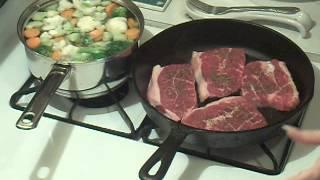 Steak , mixed vegetables, baked potato , and pasta salad