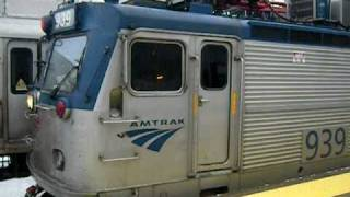 MUST SEE!!!! Amtrak engineer climbs out of AEM7 and shovels snow in front of train!