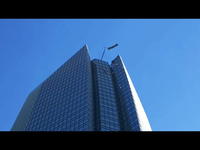 Men Caught In High Winds on Skyscraper