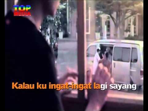 Anji   Berhenti Di Kamu Official Music Video KARAOKE TOP MEDIA xvid