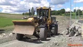 4K| Caterpillar 160M Grader Spreading Gravel