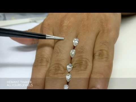 pear-shape-diamond-size-comparison-on-hand-real-view