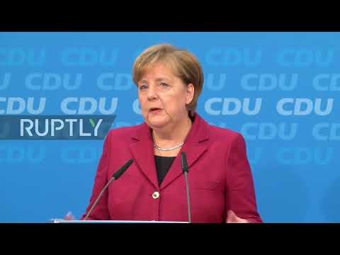 Germany: Merkel denounces burning of Israeli flags, presses for 'stable government'