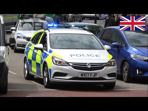 Avon And Somerset Police cars responding with siren and lights