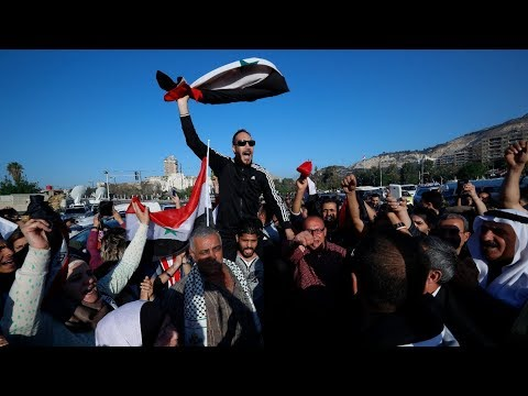Pro-Assad supporters rally against US, UK and France after Syria air strikes | ITV News