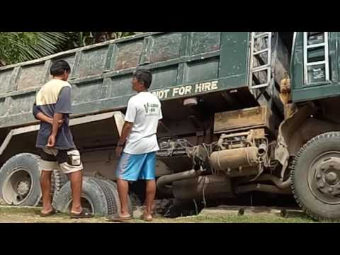 A truck loaded with gravel slipped away in the Philippines