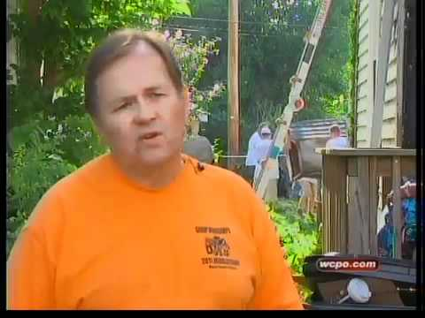 Volunteers help low-income families with home repairs
