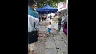 toddler picked up steel pipe to defend his grandma from china s urban management force