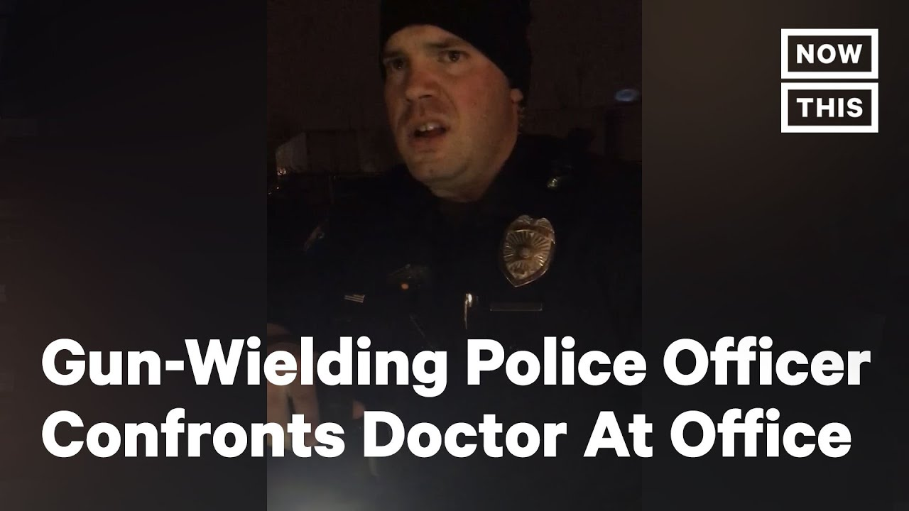 Download Gun-Wielding Police Officer Confronts Doctor At His Office | NowThis