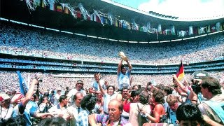 Diego Maradona receives and lifts the World Cup trophy