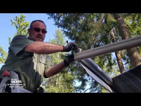 torn-rv-awning-with-a-failed-motor-gets-removed-and-replaced