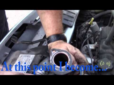 How To Replace The Thermostat On A 2005 Chrysler Town And