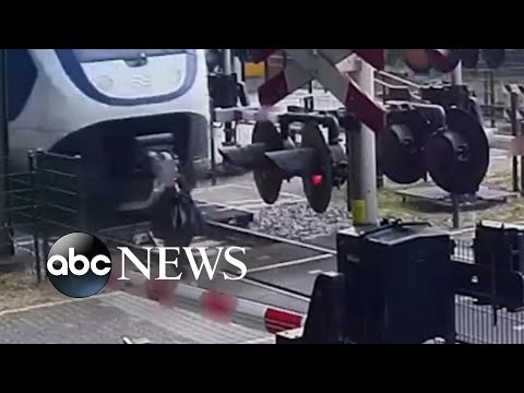 Woman narrowly escapes being hit by a train  shorts  ABC News