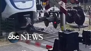Woman narrowly escapes being hit by a train | #shorts | ABC News