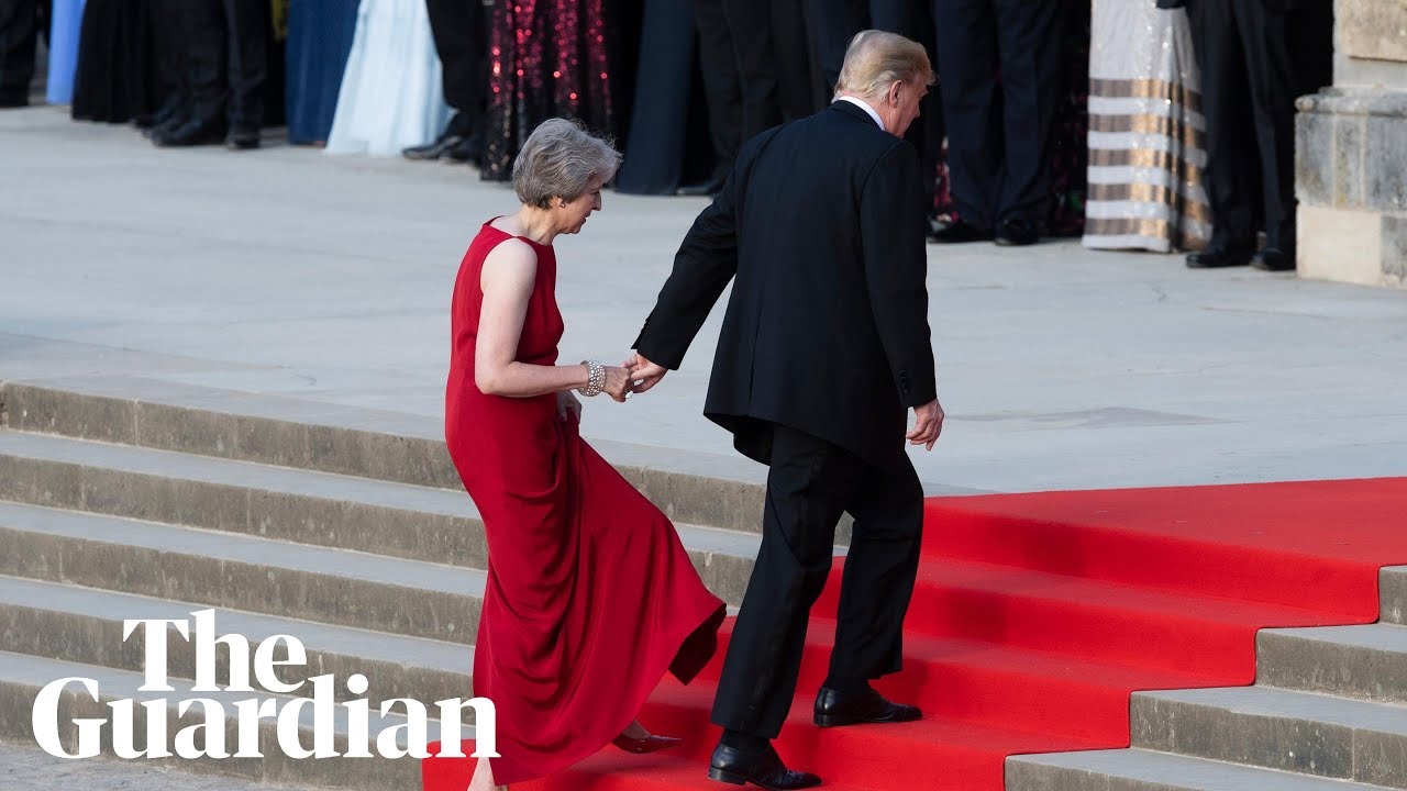 Trump and May briefly hold hands in awkward echo of previous meeting