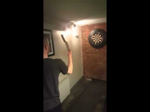 Irish darts legend nails a 20 with 20 inch chef knife on 2nd go