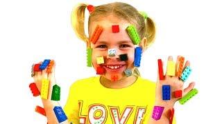 Eve became a LEGO girl I Eva Pretend play LEGO HANDS ليغو تعلق في وجه !!
