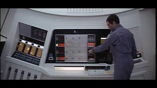 2001: A space Odyssey. Dave Bowman removes hot food from the oven.