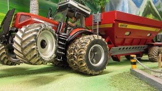 RC TRACTOR  pulls heavy load - farm toys in action