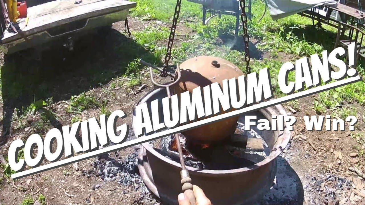 Melting aluminum cans over the fire pit in a propane tank  Trying to make  ingots