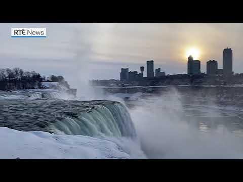 Frozen Falls: Rainbow brightens sky over icy Niagara