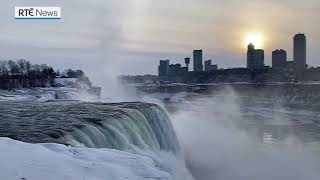 Frozen Falls: Rainbow brightens sky over icy Niagara