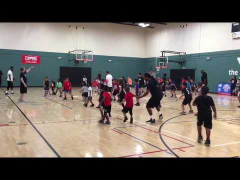 Former LA Clipper Lamond Murray and Clipper Staff practice with kids at YMCA