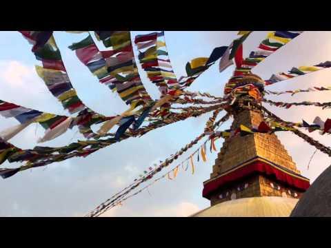 Tibetan Buddhist prayer flags waving at Boudhanath Stupa, Nepal