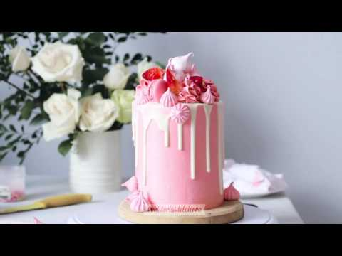 White Cake With Pink Frosting And Strawberry