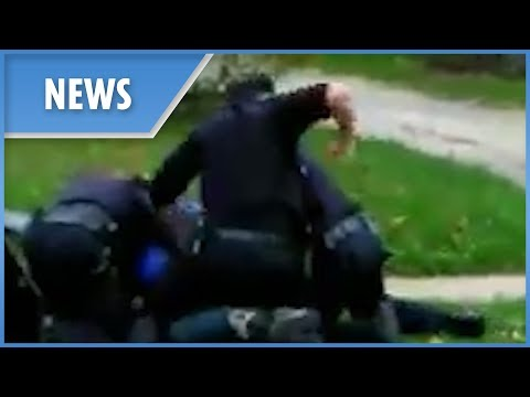 Police appear to brutally punch restrained suspect (Akron) F