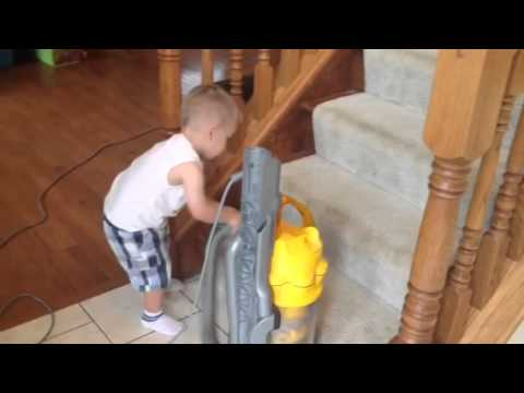 Andrew helping vacuum the stairs