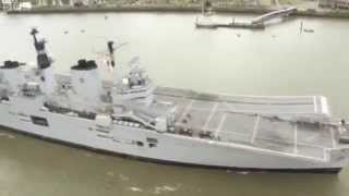 HMS Illustrious negotiates Thames Barrier
