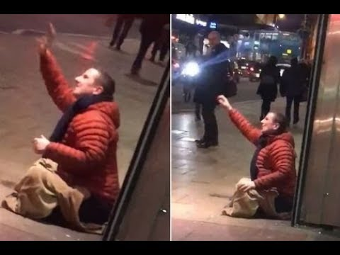 Police launch investigation into 'aggressive begging' after man is filmed shouting abuse at people w