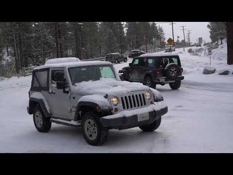 Cars sliding on Maple Lane after recent snowfall in Big Bear, CA