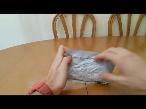 unboxin tres paquetes de aliexpess con un tripode muy economico y de buena calidad, un masajeador y