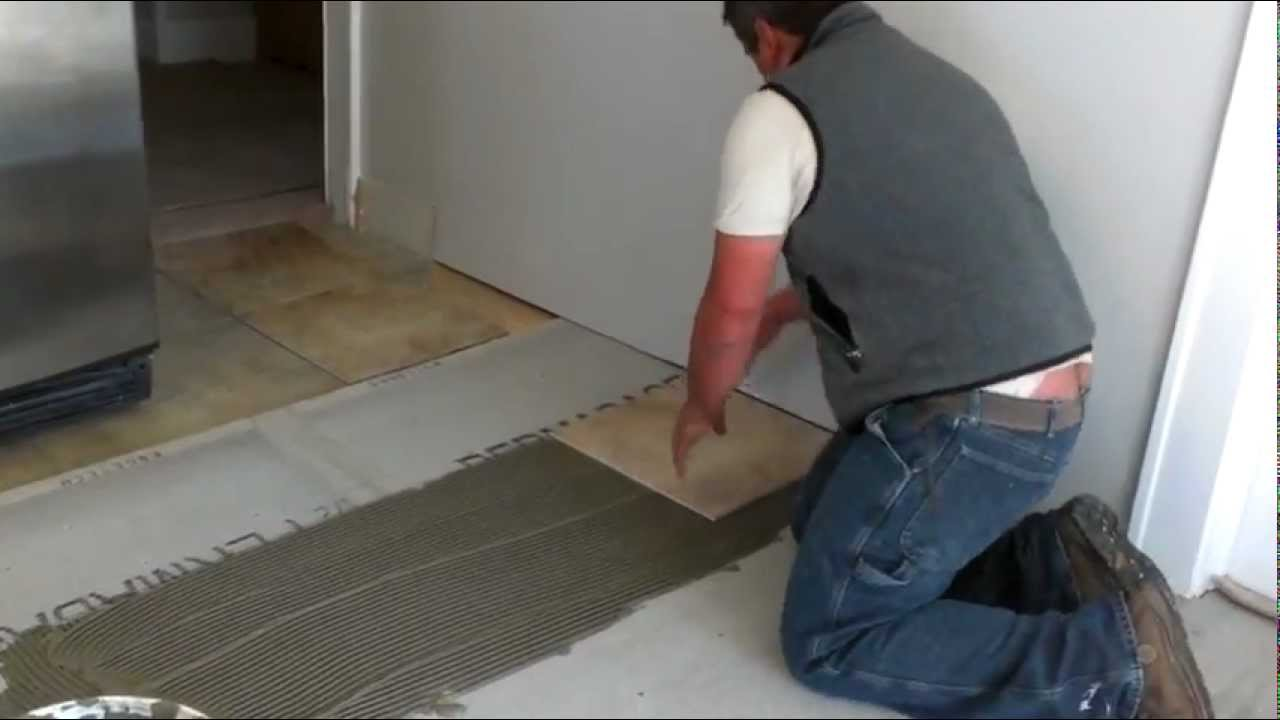 How To Install Ceramic Tiles On A Floor YouTube - Cost of installing tile floor in kitchen
