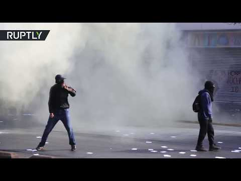 Police unleashes water cannons on protesters in Chilean capital on May Day